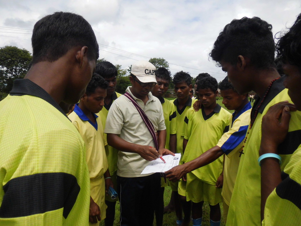 Br. Ajit (manager) with the team.